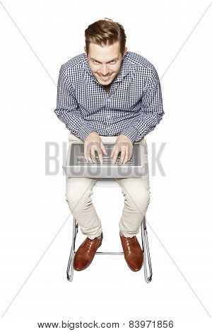 Happy Man Working On A Computer