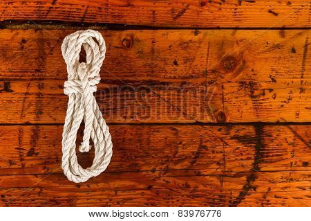 White Rope Against Textured Wood