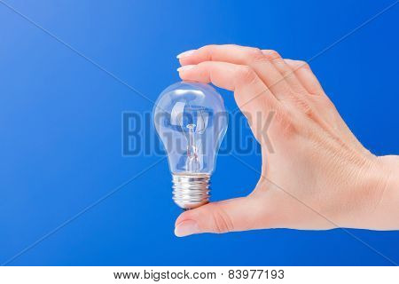 Hand Holding A Incandescent Light Bulb