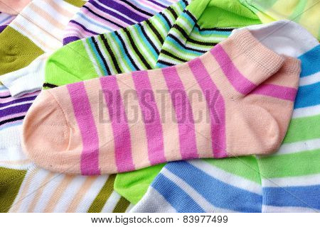 Stack Of Many Pairs Colorful Striped Socks Isolated On White