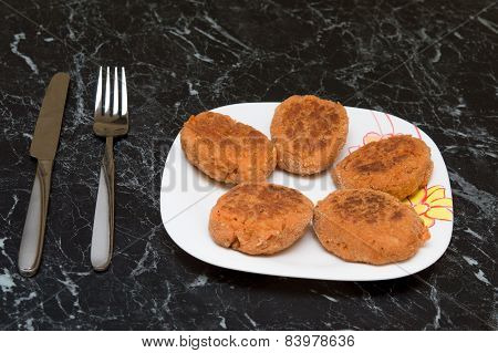 Cutlet, Knife And  Fork On  White Plate On  Marble Table. Photo