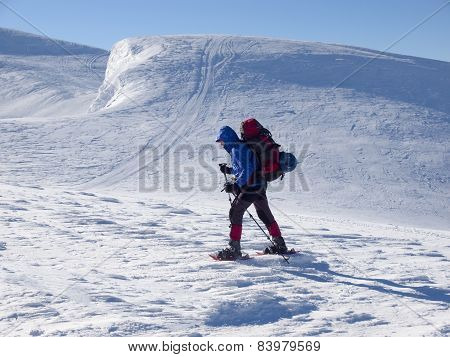 The Man In Snowshoes In The Mountains.