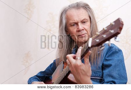 Middle-aged Man Playing Guitar Closeup