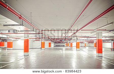 Retro Filtered Photo Of Underground Parking, Industrial Interior.