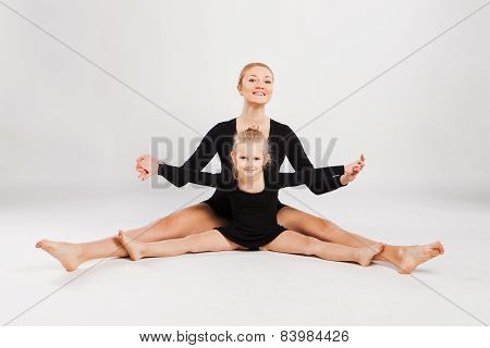 Mom teaching daughter choreography. Daughter  and mother gymnastics