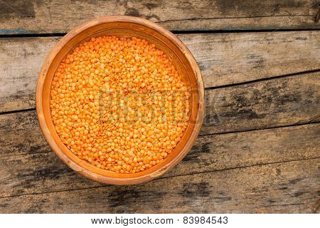 Raw Lentil In Bowl On Wooden Background