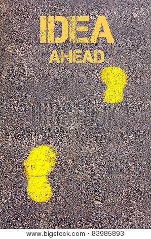 Yellow Footsteps On Sidewalk Towards Idea Ahead Message