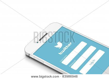 Gdansk, Poland - March 2, 2015: White Mobile Phone With Twitter Social Network Isolated Over White
