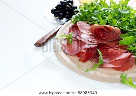 Italian Smoked Ham Bresaola With Arugula And Olive