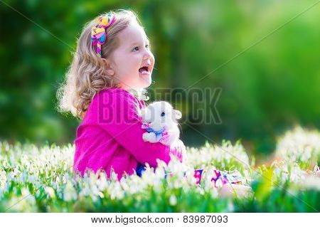 Little Girl Playing With A Rabbit