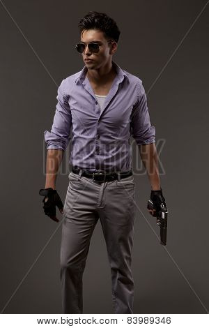 Shooter With Handgun, Glasses And Gloves