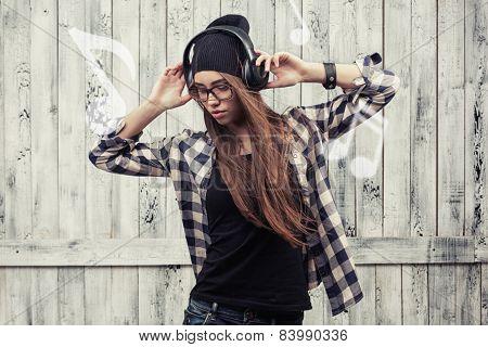 girl in glasses, headphones and black beanie