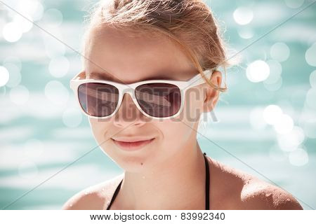 Little Blond Girl In Sunglasses, Closeup Portrait
