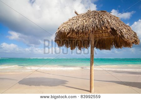 Wooden Umbrella On Empty Sandy Beach