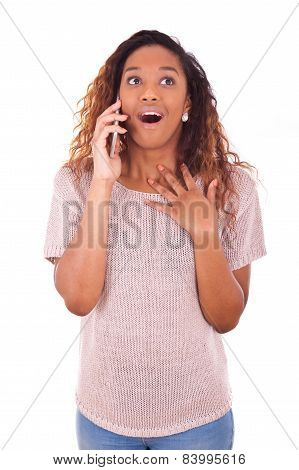 Ecstatic Young African American Woman Making A Phone Call On Her Smartphone - Black Teenager People