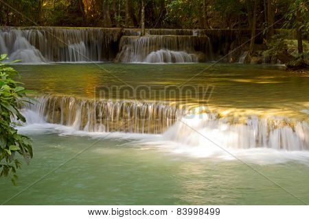 Waterfall In Forest With Sunlight