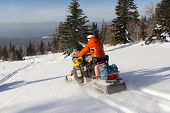 stock photo of ural mountains  - Men snowmobile sent to help a friend - JPG