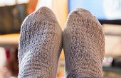 foto of stocking-foot  - feet propped up relaxing watching the television - JPG