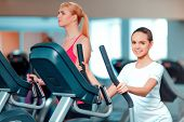 image of elliptical  - Young sport lover - JPG