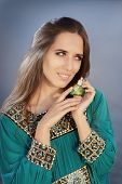stock photo of fragrance  - Portrait of a glamorous woman with retro fragrance recipient in beautiful seascape - JPG