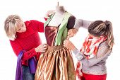 pic of dress mannequin  - two happy seamstresses working on a dress on a mannequin isolated over a white background - JPG