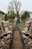 picture of shovel  - handyman digging out with shovel a line - JPG