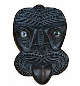 stock photo of tiki  - Maori Wood Carved Tiki Mask isolated with clipping path - JPG