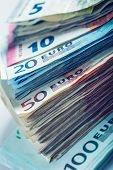 picture of money stack  - Several hundred euro  banknotes stacked by value - JPG
