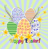 image of risen  - Greeting card for Easter with ornament from painted eggs and daffodils - JPG