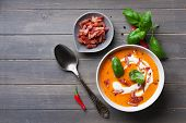 image of bacon  - Carrot sweet pepper cream soup with bacon on old wooden background - JPG