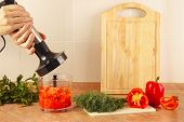 stock photo of blender  - Hands chefs are going to mix red pepper and tomato in a blender - JPG