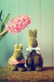 stock photo of ester  - Two Ester bunnies with a pink hyacinth - JPG