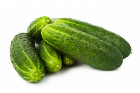 stock photo of cucumbers  - Bunch of ripe cucumbers isolated on white background - JPG