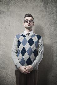 foto of nerds  - Nerd pensive guy posing and looking at camera - JPG