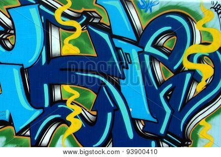 Colorful graffiti detail on a public wall