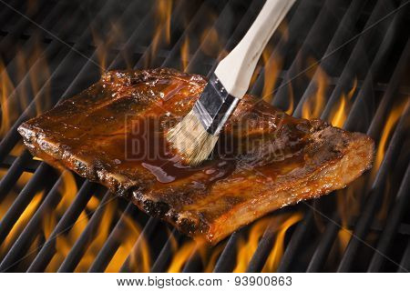 Ribs on a hot flaming grill