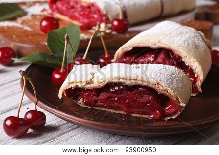 Sliced Strudel With Cherry Close-up On A Plate. Horizontal