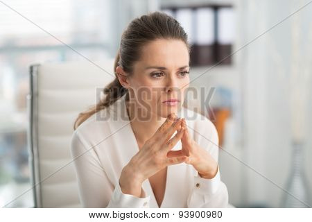 Pensive Businesswoman With Hands In Steeple Position