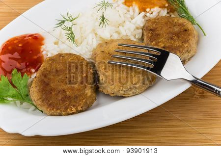 Close Up Of Fried Cutlet With Rice, Squash Caviar, Ketchup