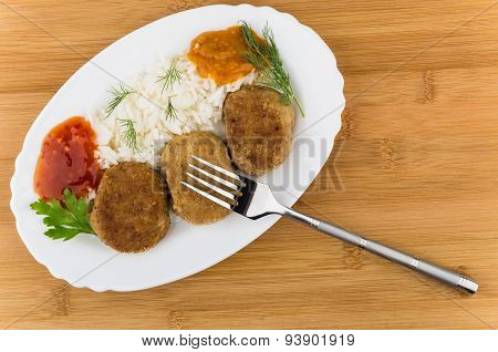 Fried Cutlet With Rice, Squash Caviar, Ketchup, Greens And Fork
