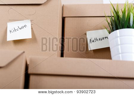 Pile Of Brown Cardboard Boxes With House Or Office Goods.