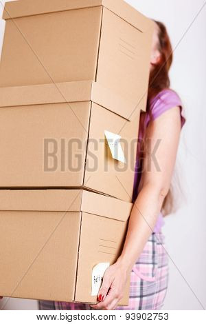 Female Hand Holding Pile Of Brown Cardboard Boxes