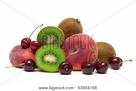 Cherries, Kiwi And Peaches Close-up On A White Background