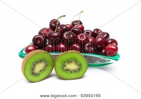 Juicy Kiwi And Ripe Cherry Closeup On A White Background