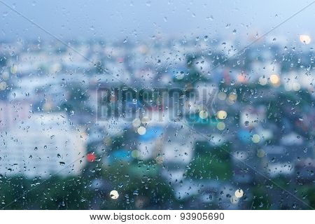 Raindrop On Glass And Bokeh In Background