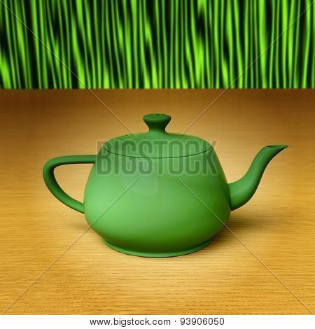 Green teapot on a bamboo mat