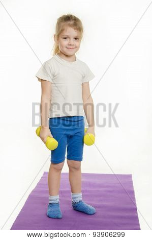 Four-year Girl Standing With Dumbbells