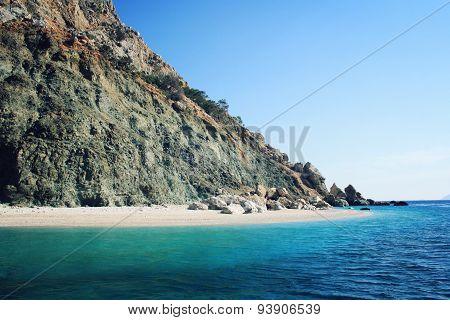 Small Beach On The Island Near Adrasan. Rocky Shore. Southern Coast Of Turkey.