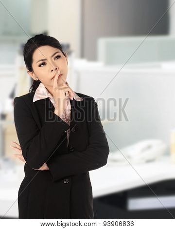 Asian Business Woman Thinking Seriously