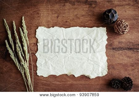 Old Wrinkled Paper On Old Wood Background With Dried Flower And Copy Space